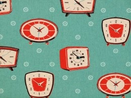 Melody Miller's red Kitschy Clocks on a teal background