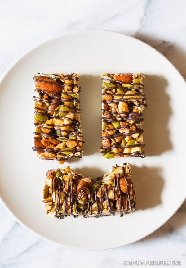 Paleo Nut Bar Recipe with Chocolate Drizzle - Easy to make, loaded with nuts and seeds, and Gluten Free, Paleo, and Vegan!! A healthy snack so tasty, you