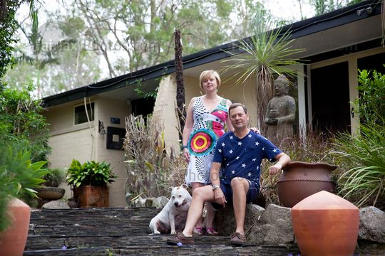 Uninsured victims of the Brisbane flood, Sharon and Jonathan Cauldwell with their son Jeremy at their property.