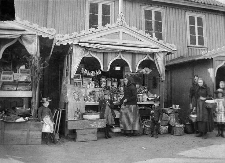 Women and children in front of Charlotta Forsberg's karamellstånd -  a sweet stand - in Strömstad, Sweden, 1890s