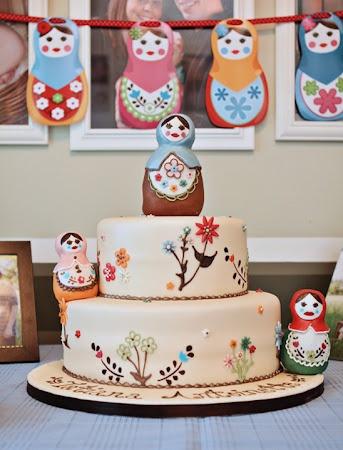 Matryoshka Cake... love nesting egg dolls!  love the flowers on the cake