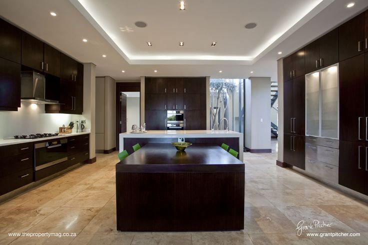 Kitchen, wooden features, wooden doors and draws, granite counters