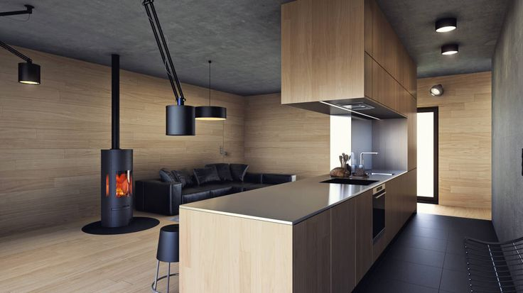 Stunning, minimalist modern design with cylinder fireplace and chic, wooden style kitchen with black floors. Uniwersalny comfort (aranżacja #2) by INDEA