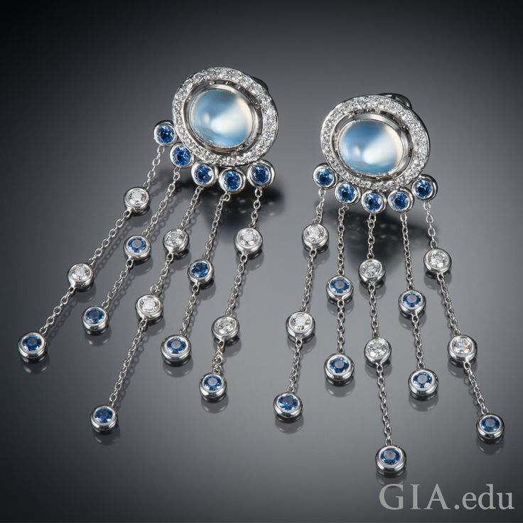 Platinum earrings featuring moonstones, diamonds and Montana sapphires