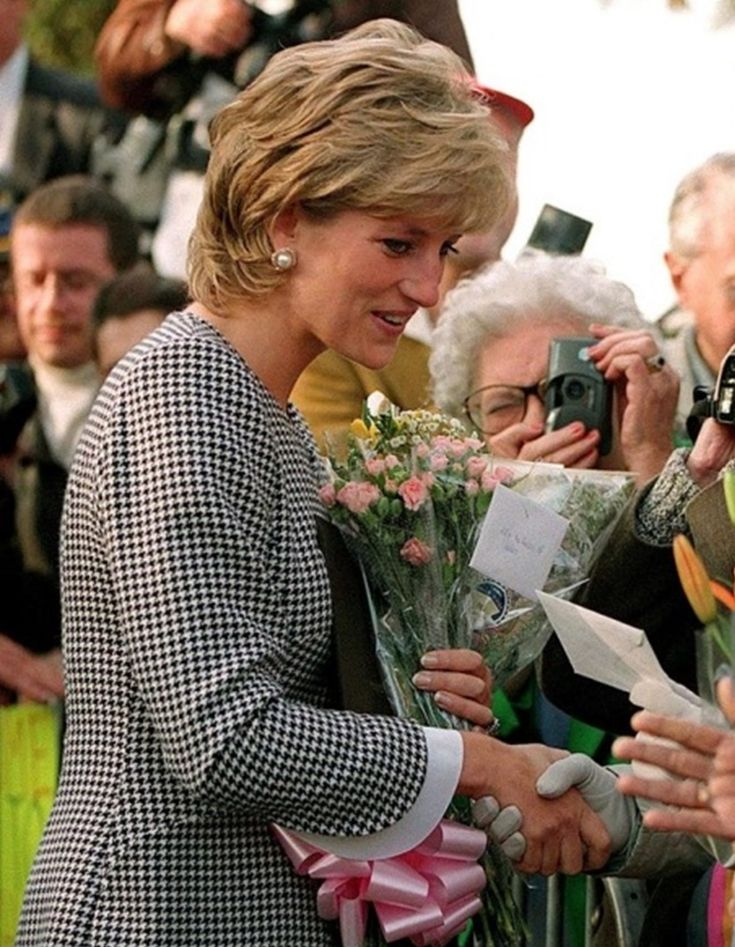 October 31, 1995 Princess Diana meets members of the public before opening the Foundation for Conductive Education for the disabled in Birmingham