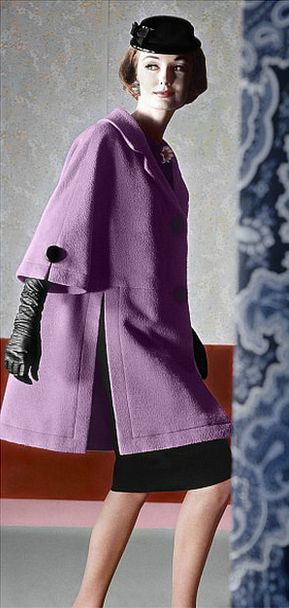 1961 Model in three-quarter lilac coat with slit side panels worn over slim black skirt by Dan Millstein