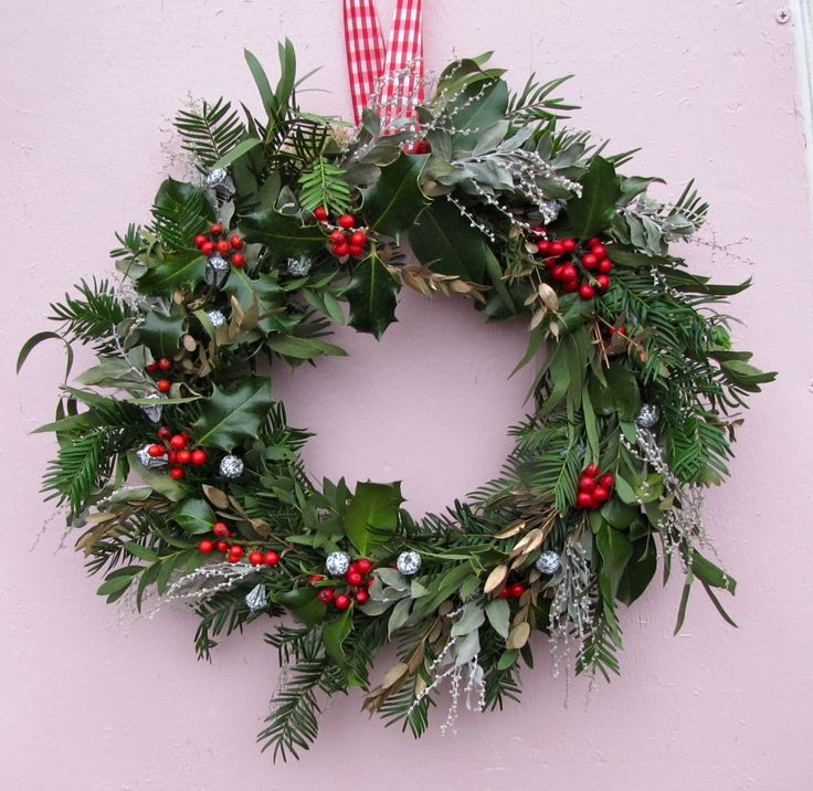 Our take on a traditional wreath, Holly, Mimosa, Spruce and Eucalyptus