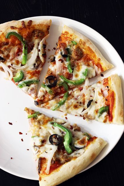 Make pizza night super duper out of this world with homemade pizza. This recipe is supreme with vegetables and two types of meat. Yum!