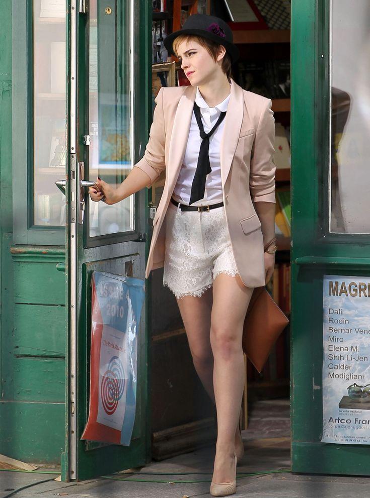 Emma Watson. White collared top + black tie + white lace shorts + black belt + cream blazer + neutral heels.