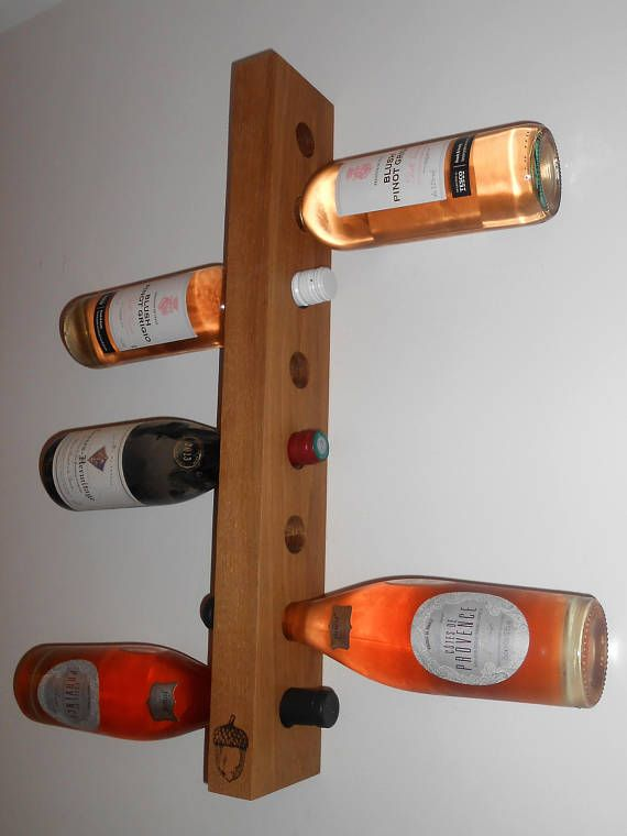 Beautifully handmade, wall hanging wine racks, designed for either 8 or 4 bottles. A perfect display piece for any entertaining room. Burnished with our eye catching acorn logo, fitted with hanging brackets for easy installation and treated with teak oil for protection. Small –