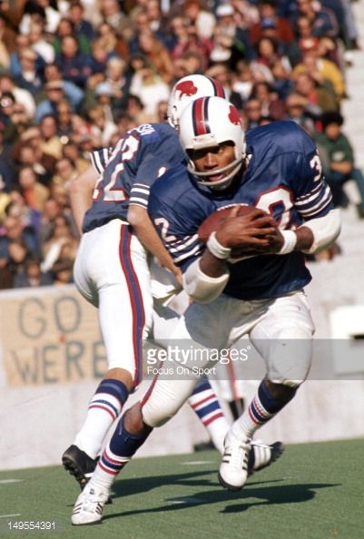 Running back OJ Simpson of the Buffalo Bills carries the ball against the Baltimore Colts during an NFL football game at Rich Stadium October 14 1973...