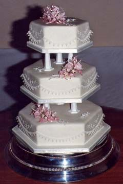 how to get a wedding cake level three level hexagon white cakes as separate tiers 15733