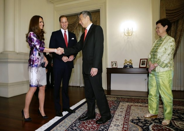 Singapore's Prime Minister Lee Hsien Loong greets Catherine, Duchess of Cambridge, before their meeting at the Istana in Singapore