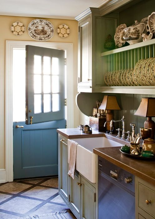 Cottage kitchen, tile floor with wood inlay, dutch door, wood counters, plate rack, pale green cabinets, farm sink...