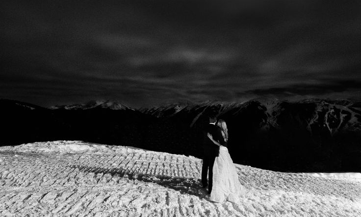 Bride and Groom on snow capped mountain - Otto Schulze