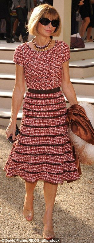 Smart move: The understated sandals don't compete with her outfits (pictured in 2010)...