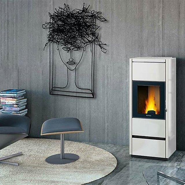 Pure-white, really elegant, it even comes with a remote control, a remote operated system and a humidifier and fragrance diffuser. What else could you wish for?  Piazzetta, stove P980  #designbest #stove #interiordecor