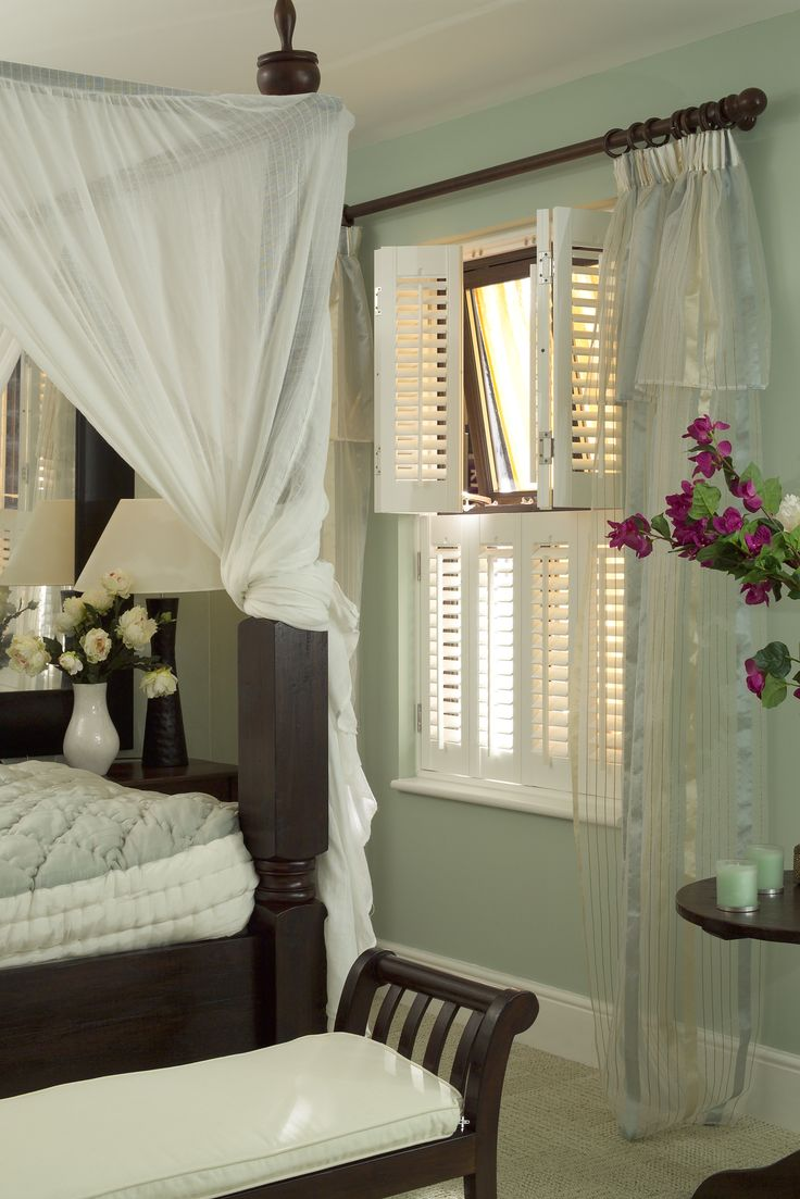 Pretty white cafe style window shutters