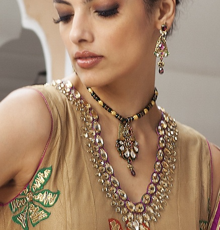 Necklace and earrings in antique gold finish with kundan, rhodolite stone and beads mala by Benzer priced at $249. Buy online at www.benzerworld.com