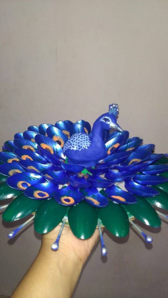 peacock made from plastic spoon More