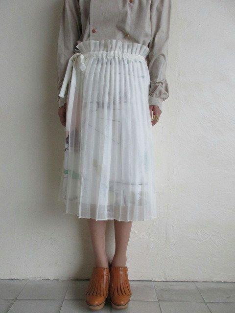 spoken words projectスポークン ワーズ プロジェクト。スカート。コレクションにないアイテムを別注したスカートです。ウールのタイトスカートに透け素材のプリーツスカートがレイヤードした…