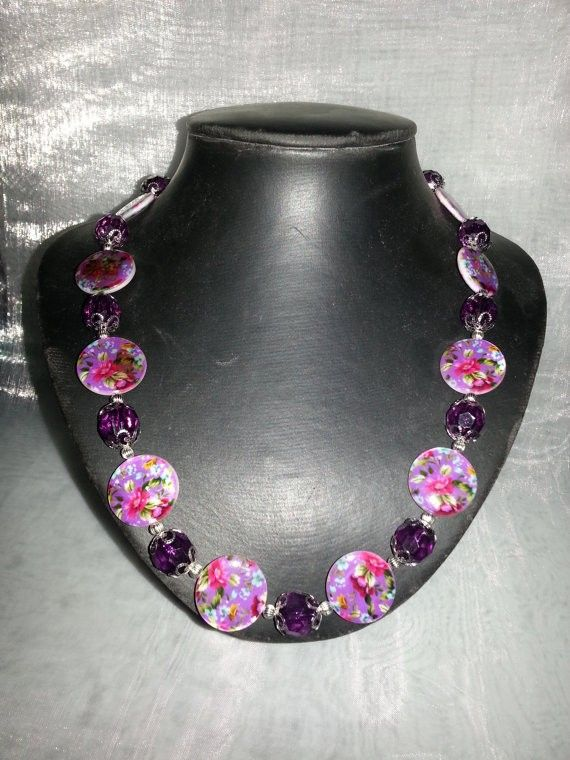 Beautiful necklace made using purple floral shell beads. Available to purchase at: http://www.etsy.com/shop/CavettaCreations