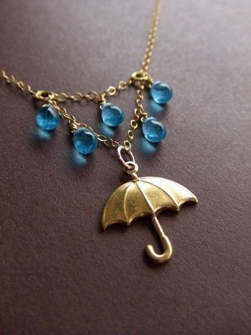 """How could you not love this necklace? It's a simple, but amazing design. I'm not usually a fan of gold-tone, but I love the necklace so much. The umbrella charm with the blue """"droplet"""" beads. So cute."""