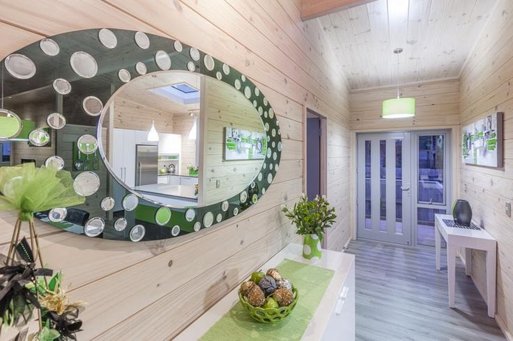Interesting black glass mirror and front door entrance in this Lockwood Takanini show home