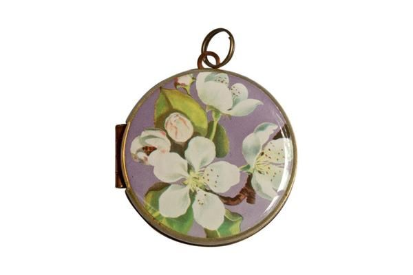 Featuring the pyrus flower, this Polish postage stamp was released in 1971.  The vintage locket is made from brass and copper and measures 30mm in diameter. The locket opens from the side and is capable of holding 2 of your most precious memories inside.