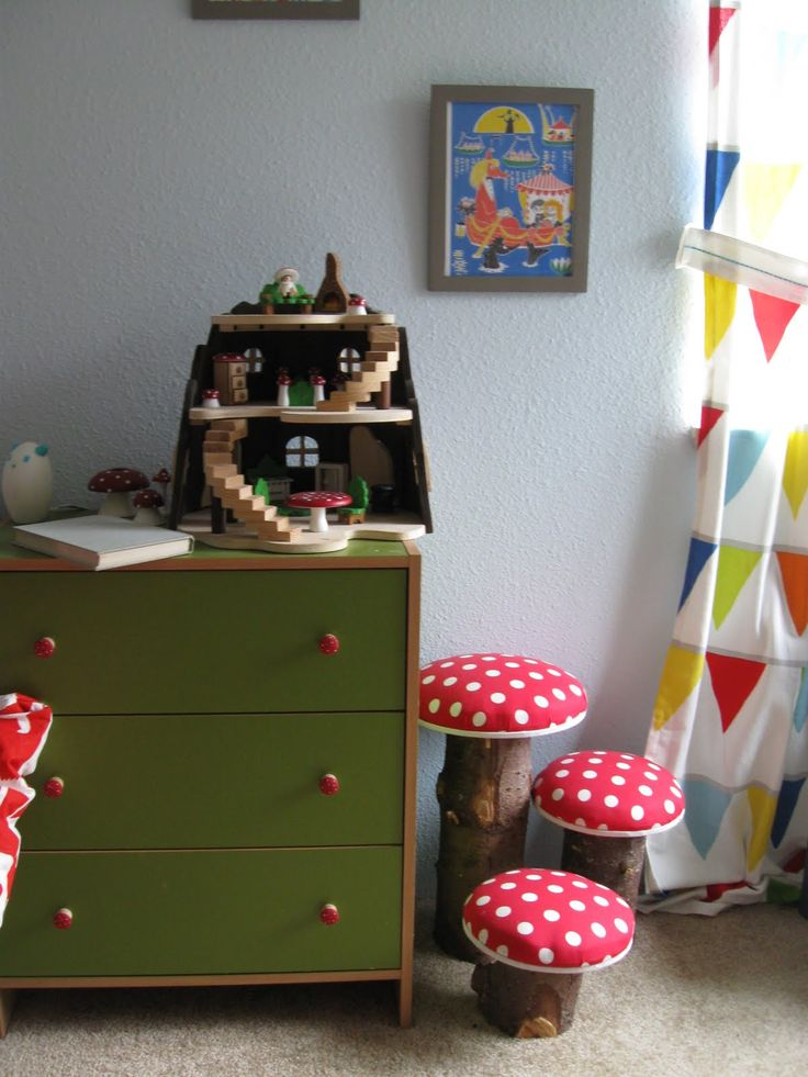 Toadstools made from tree logs add a whimsical touch to this children's room.