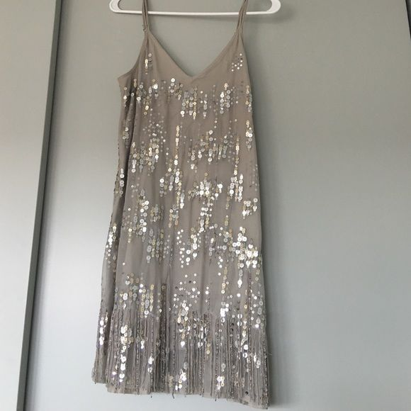 Sequin Dress From Abercrombie and Fitch Size small. Very elegant. I was shocked when I found it this past fall in the A&F store- their style has changed! This is really cute, sort of flapper style the way the beads fall at the bottom. Comfortable, not too heavy. Abercrombie & Fitch Dresses Midi
