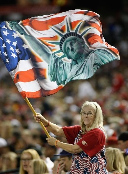 Game #83 7/4/12: An Arizona Diamondbacks fan (known as the Flag Lady due to attending most every home game with her multiple flags) waves a liberty flag during the Fourth of July game against the San Diego Padres at Chase Field on July 4, 2012 in Phoenix, Arizona. (Photo by Ralph Freso/Getty Images)