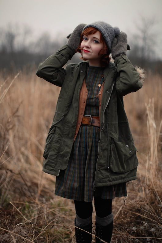 Rebecca of The Clothes Horse. hunter green parka on caramel cardigan and plaid dress. great fall color combination.