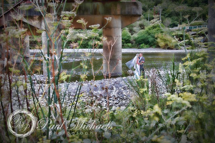 Bride and groom under the bride along the Hutt river. PaulMichaels wedding photography Wellington http://www.paulmichaels.co.nz/