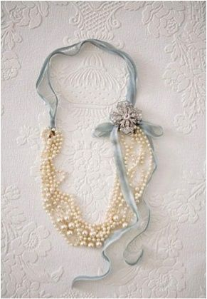 For this classy necklace, fold a long pearl necklace in half and tie ribbon around each side. Add a broach by the bow for some extra sass.