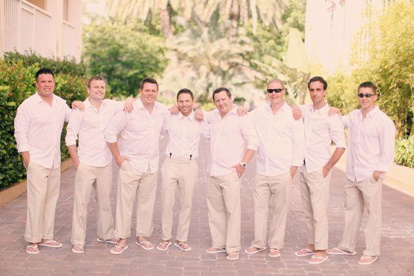 Groomsmen in white linen shirts khakis flip flops so for White linen dress for beach wedding