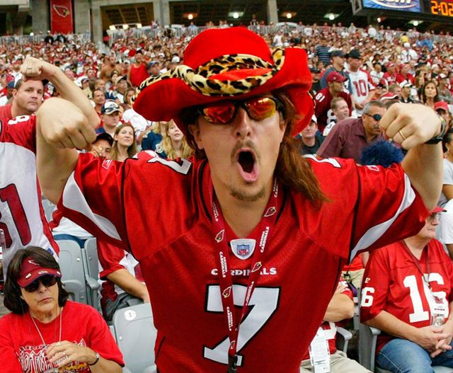 """Arizona Cardinals fan Dustin """"KidStallyn"""" Holmes of Tucson cheers during a Cardinals home game. Holmes, a software engineer, says he hasn't missed a Cardinals game since he became a season-ticket holder in 2000."""