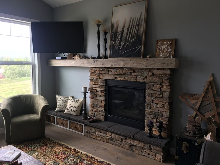 My finished, decorated assymetrical stacked stone fireplace