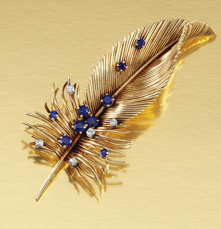 SAPPHIRE AND DIAMOND BROOCH, BOUCHERON, 1950S. Designed as a stylised feather, embellished with claw-set circular-cut sapphires and brilliant-cut diamonds, signed Boucheron Paris and numbered, French assay marks and maker's marks.