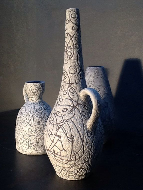 A beautifully designed Filigran vase by Adele Bolz, for Ruscha pottery, circa 1959/60. It is hard to believe that this is around 65 years old, as the mermaid figure, deers, fishes and geometric shapes are as current today as they where back at the time this was made. Adele Bolz came from being a ballet dancer after WWII to work for Ruscha in 1959. The production of her intricate glaze only lasted 2 years before her time was cut short and after leaving her illness became to deteriorate be...
