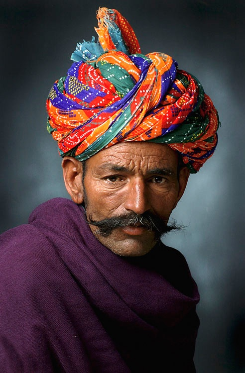Portrait of rural man in colourful turban ; Jodhpur ; Rajasthan ; India