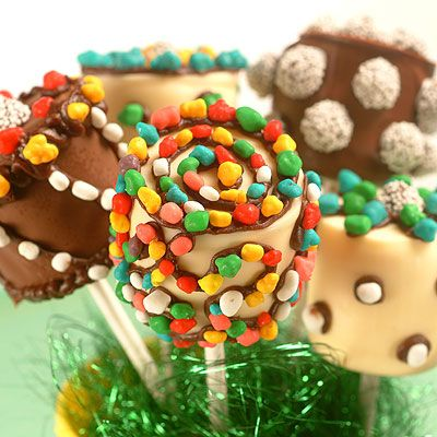 Marshmallow Pops On a Stick | Meals.com -  Marshmallow Pops are a fun and simple craft to try at your next birthday party or next time the kids are bored and want to try something new. These could be a fun surprise at cookie exchange without the work of cake pops. #onastick #TollHouse #birthdayparty #partyfavors