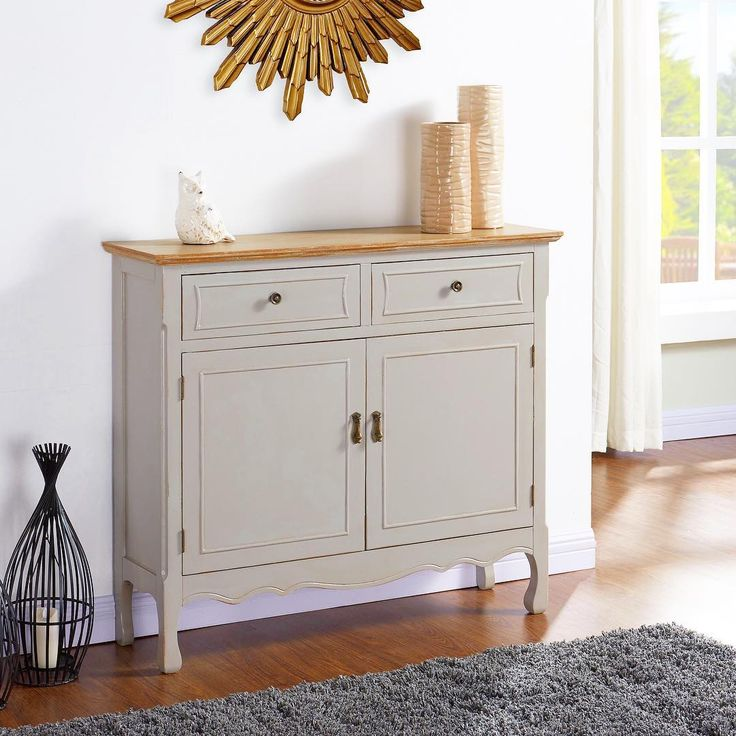 French white, any time of year... http://inspireathome.com/accent-furniture/console-tables-cabinets/marcela-cabinet-in-grey.html
