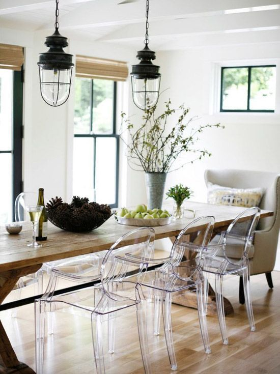 Love the mix of acrylic ghost chairs and farmhouse table. Simply modern with rustic elements. - Modern Rustic #interiordesign