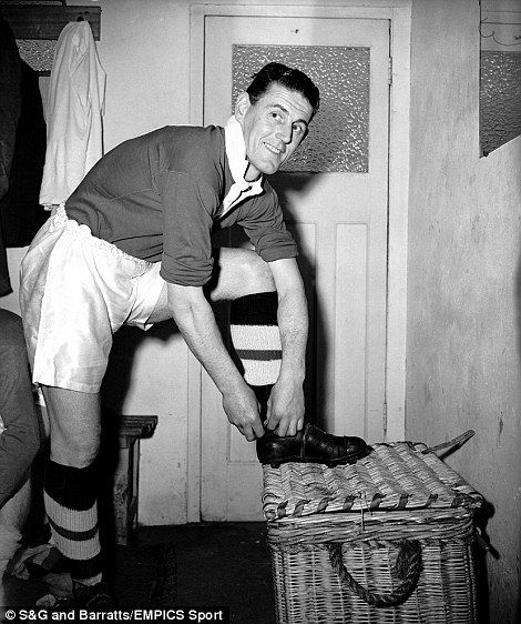 Chelsea defender Stan Willemse puts on his boots before a friendly match against Hayes in 1955. Willemse played for three clubs during his career - Brighton, Chelsea - he was with the west London club for seven years - and Orient. When Chelsea won their first league title for half a century in 2005, Willemse and fellow 1955 title winner Roy Bentley carried out the trophy at Stamford Bridge for it to be presented to Blues captain John Terry