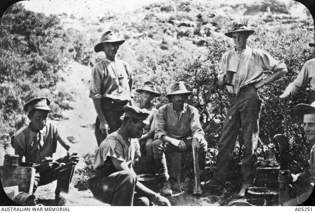 Gallipoli, 1915. A group of ANZACS making a meal.
