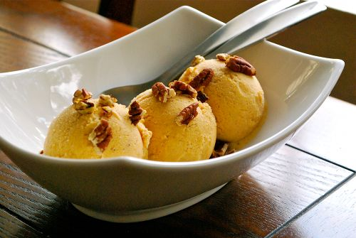 Pumpkin Frozen Yogurt with Roasted Pecans (asweetpeachef) - makes me want to purchase an ice cream maker