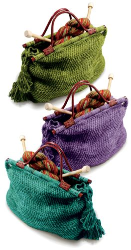 "Our popular knitting tote is sturdy and stylish in Suede. Size Approximately 15"" wide x 11"" high (Not including handles) x 4 1/2"" deep. Materials Berroco Suede (50 grs), 5 balls #3715 Tonto Green or #3745 Calamity Jane Purple or # 3769 Sundance Kid Turquoise 24"" length circular knitting needle, size 8 OR SIZE TO OBTAIN GAUGE. Crochet hook, size 4.00 mm (F). 1 Pair wooden handles with 13"" wide bar at bottom. Four 7/16 "" goldtone grommets."