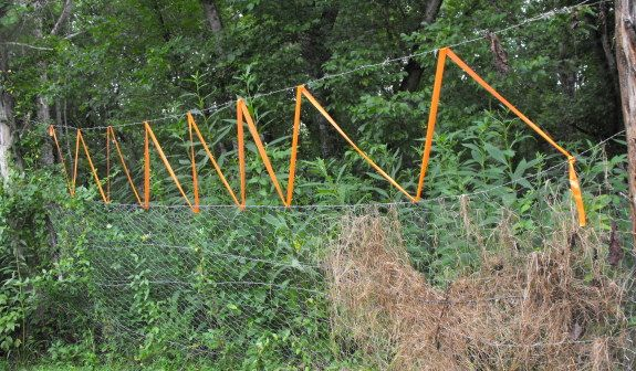 How To Use A Roll Of Orange Plastic Ribbon Like Marking Tape S Up Hole In The Top Deer Fence Designed Keep Out Garden