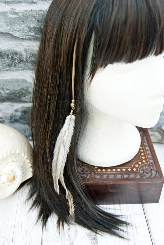 Feather hair clip extension featuring two natural emu feathers, bronze beads and faux suede. Add some gorgeous Ibiza Boho style glamour to your hair with the Keshinomi Feather Hair Jewellery. Whispy natural coloured emu feathers will create an ethereal look to your hair style. This colour